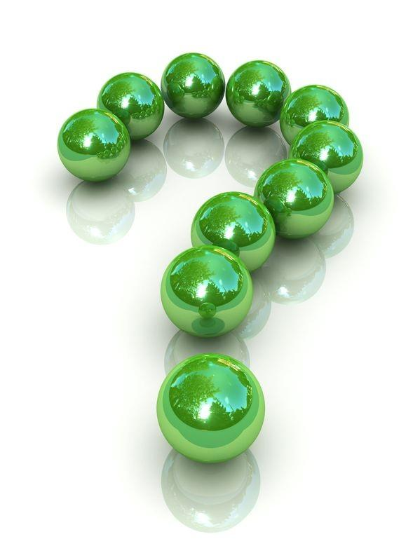 Question mark made of green baubles