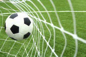 Football Hitting Back of the Net