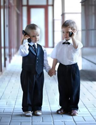 2 Young Boys on Mobile Phones