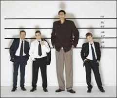 Line Up with One Very Tall Man