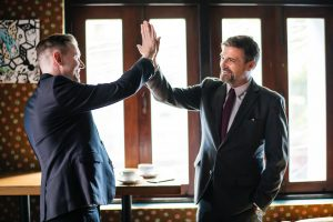 2 men high five
