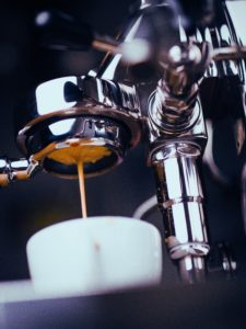 coofee brewing through a coffee machine