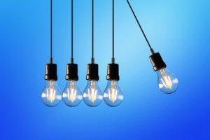 Hanging lightbulbs signify innovation